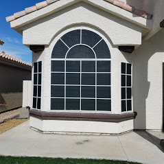arched and square windows black solar screens white frames