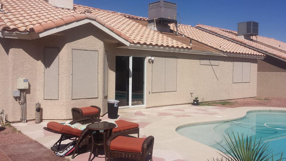Sand solar screens facing pool