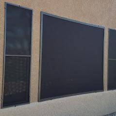 Oversized and casement windows black solar screens bronze frame