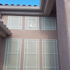 6 square windows stucco screens white frames