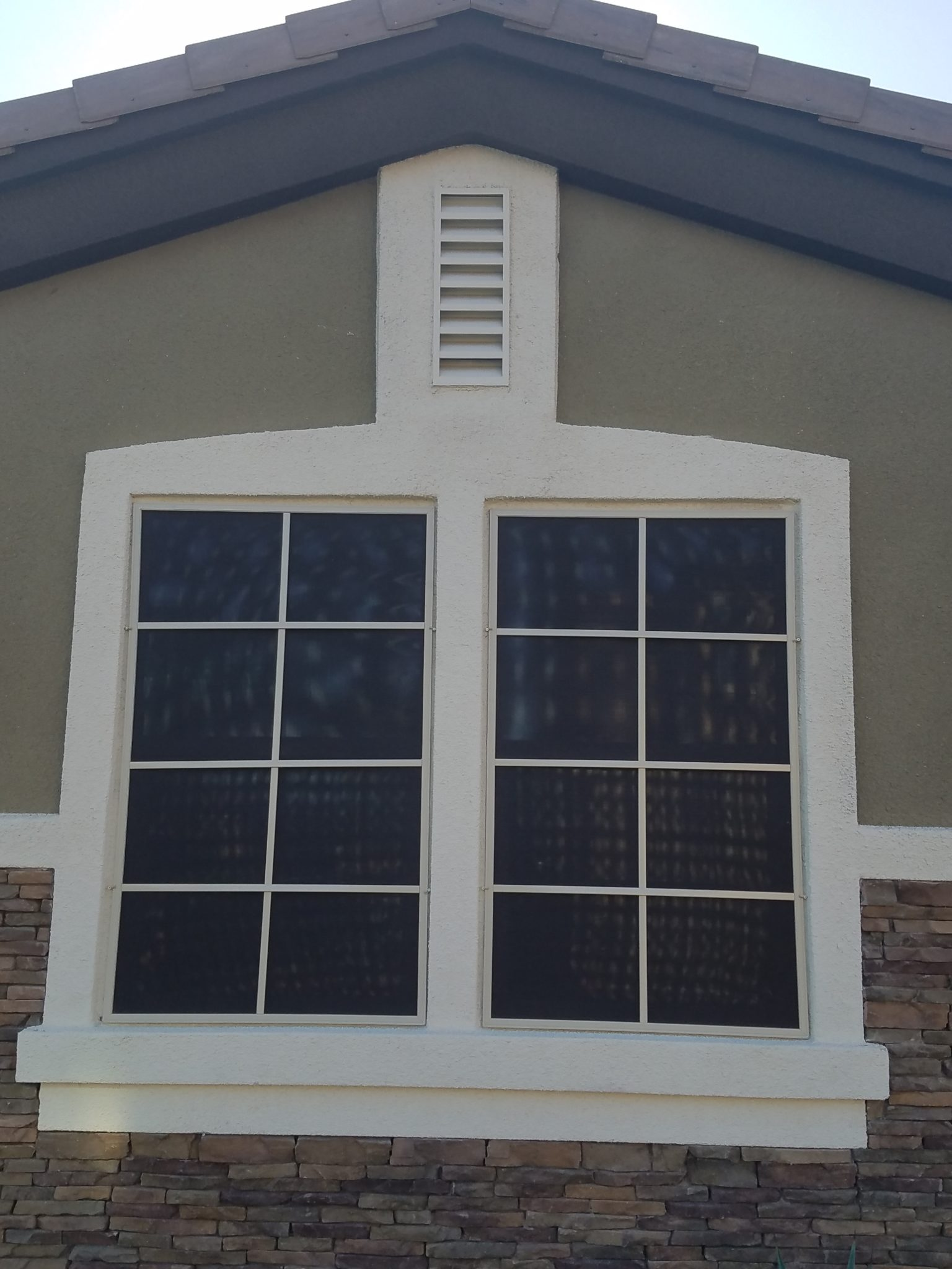 side by side windows after black solar screens