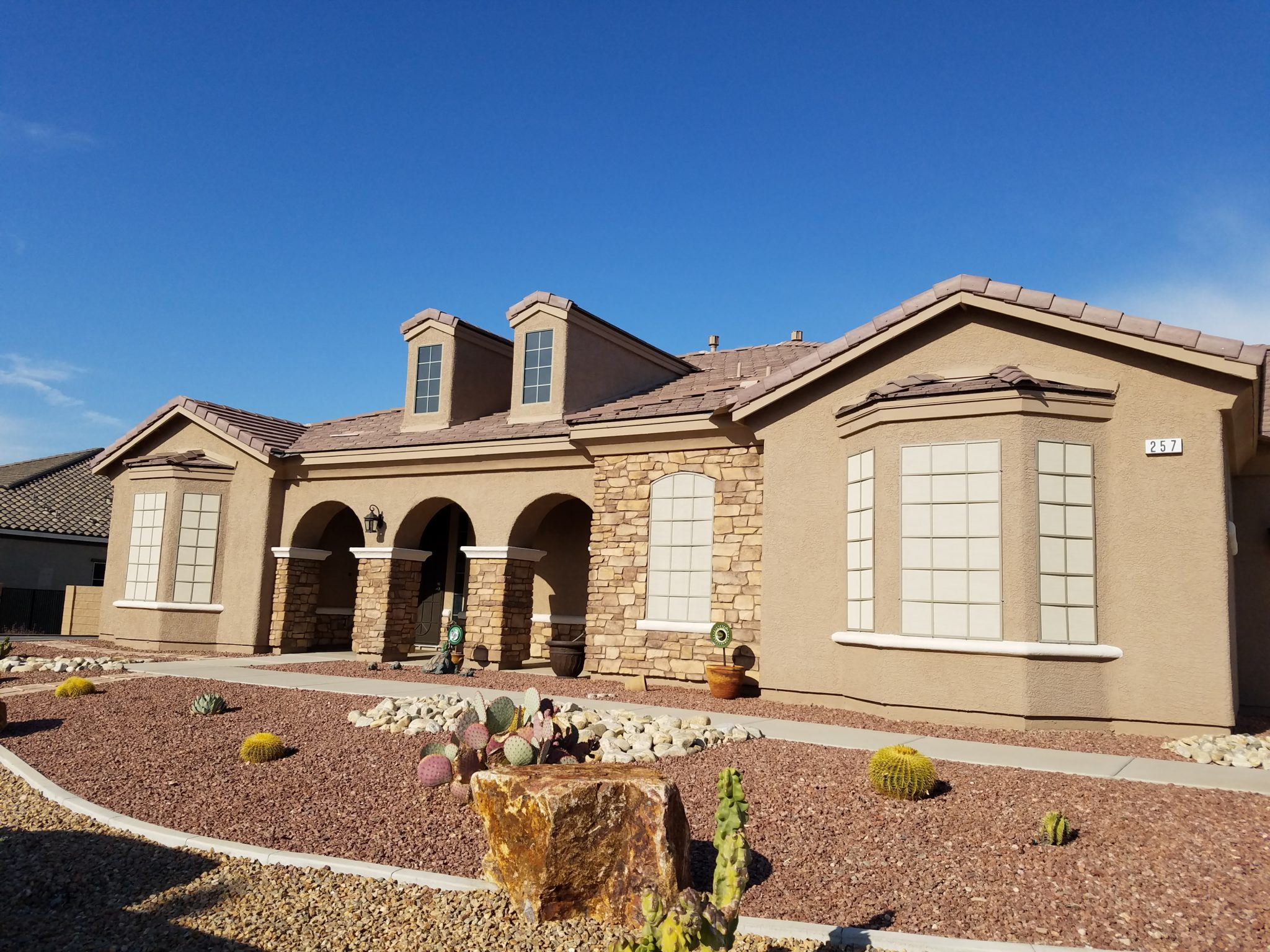 1 story home with solar screens two different colors