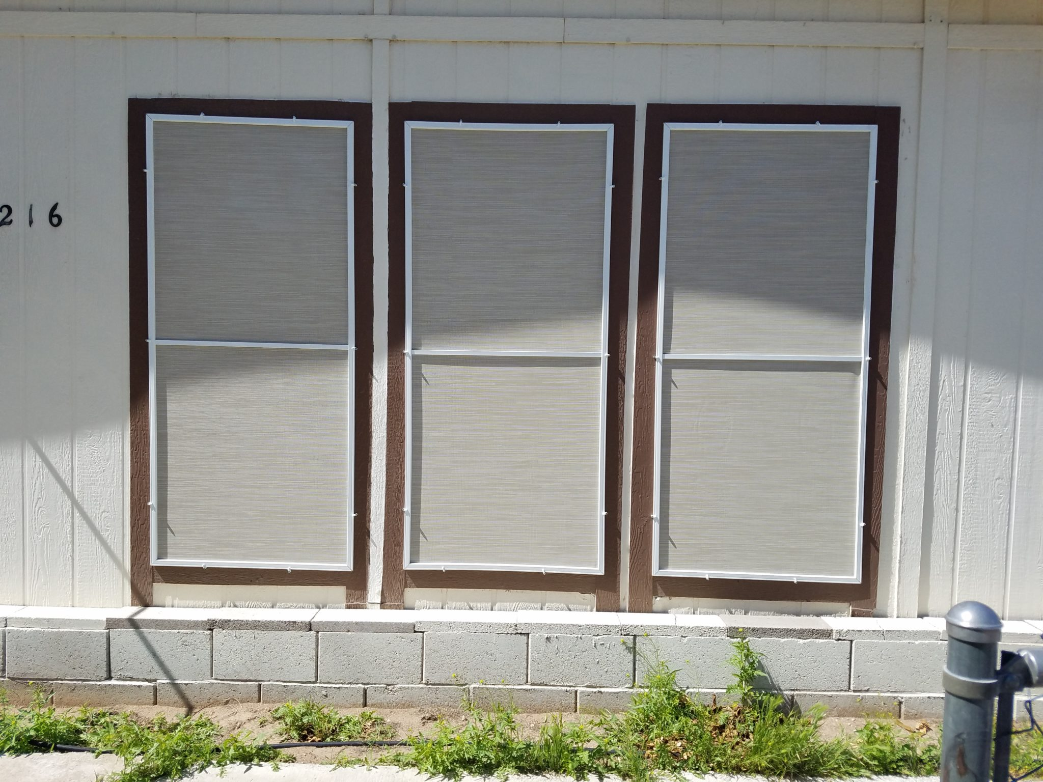 3 double-hung windows after