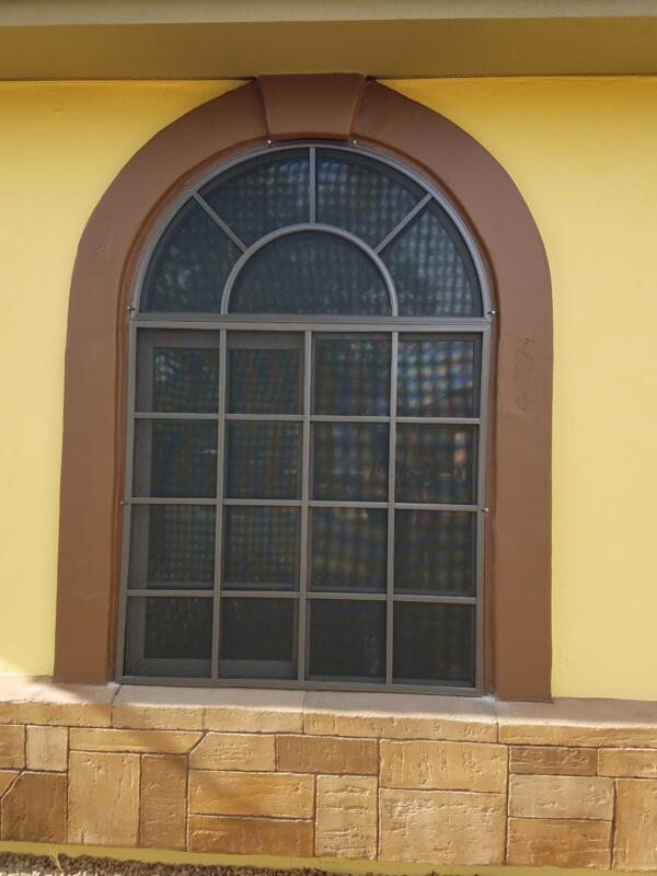 Arched exterior framed sun screen