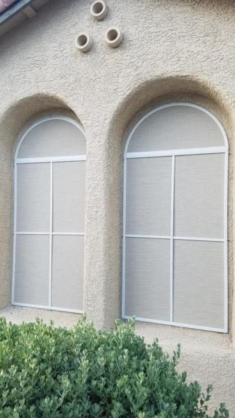 Solar screens on arched windows add privacy